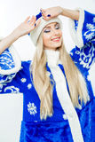 Portrait of a Snow Maiden in a blue suit. Royalty Free Stock Photography