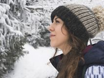 Portrait of snowboarder girl on the background of snow forest Royalty Free Stock Photos