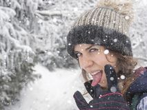 Portrait of snowboarder girl on the background of snow forest Royalty Free Stock Images