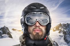Portrait of a snowboarder in wintry environment Royalty Free Stock Image