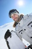 Portrait of a snowboarder on the slopes Royalty Free Stock Photo