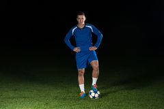 Portrait Of A Soccer Player On Black Background Stock Images