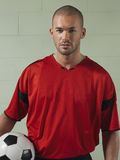 Portrait Of Soccer Player Holding Ball Royalty Free Stock Photography