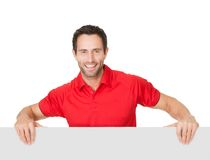 Portrait of soccer player presenting empty banner Stock Image