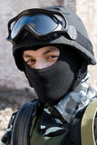 Portrait of a soldier. Young adult soldier in full ammunition - mask, helmet,glasses,vest stock photo