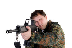 Portrait of a soldier aiming a gun Royalty Free Stock Photos