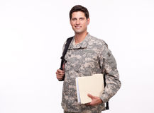 Portrait of a soldier with backpack and documents Stock Photo
