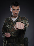Portrait of soldier in camouflage fighting Royalty Free Stock Photos