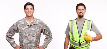 Portrait of a soldier and construction worker posing against white. Smiling soldier and construction worker posing stock image