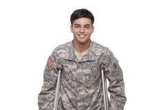 Portrait of a soldier with crutches smiling Royalty Free Stock Images