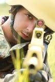 Portrait of soldier in helmet targeting Stock Image