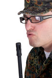 Portrait of a soldier holding a gun Royalty Free Stock Photography