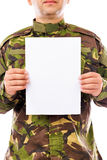 Portrait of a soldier holding white sheet of paper Stock Photos