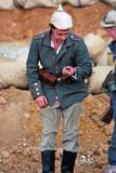 Portrait of a soldier-reenactor holding a bullet. Stock Photo