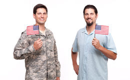 Portrait of soldier and young man holding American flags Stock Photo