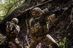 Portrait of soldiers on reconnaissance. With machine guns royalty free stock image