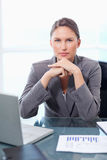 Portrait of a solemn businesswoman working Royalty Free Stock Photo