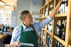 Portrait of sommelier taking inventory in wine store. Portrait of sommelier in wine store royalty free stock photo