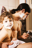 Portrait of son and father enjoying while shaving together, lifestyle people concept, happy family Stock Photos