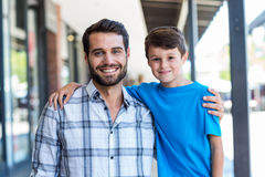 Portrait of a son and a father. At the mall stock photos