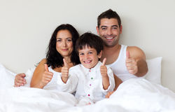 Portrait of a son with thumbs up and his parents i Stock Photography