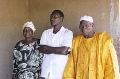 Portrait of a son to his parents. Home in front of their house in Ouagadougou Royalty Free Stock Photo