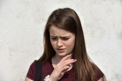 Portrait of a sorrowful looking teenage girl royalty free stock images