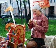 Portrait of a souvenir seller. Stock Images