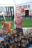 Portrait of a souvenir seller. Royalty Free Stock Image