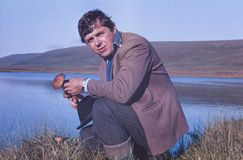 Portrait of soviet gold-prospector mushrooming in tundra Royalty Free Stock Photos