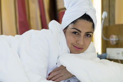 Portrait of spa  woman laying in the bed. Portrait of beautiful woman with white towel Royalty Free Stock Images