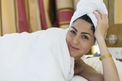 Portrait of spa  woman laying in the bed Royalty Free Stock Image