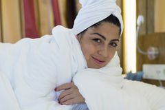Portrait of spa  woman laying in the bed. Portrait of beautiful woman with white towel Stock Images