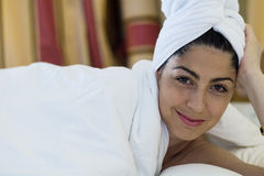 Portrait of spa  woman laying in the bed. Portrait of beautiful woman with white towel Royalty Free Stock Photos