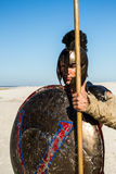 Portrait of a Spartan warrior with an ancient shield royalty free stock photography
