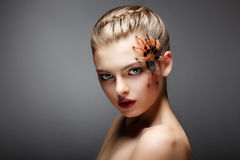 Portrait of Spider-Girl Fashion Model with Poisonous Spider on her Face Stock Image