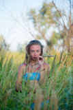 Portrait of a spikelet. Portrait of a young girl with a spikelet in the mouth Royalty Free Stock Images