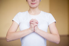 Portrait of a spiritual young woman doing yoga mudra turtle. Portrait of a spiritual young women doing yoga mudra turtle in gym Stock Images