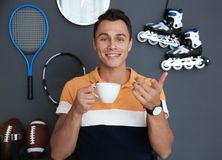 Portrait of sport blogger with cup of coffee royalty free stock images