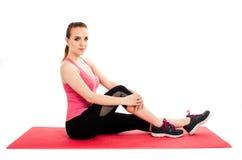 Portrait of sport girl doing yoga stretching exercise, isolated on white background. Stock Photos