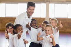 Portrait of sport teacher and students showing thumbs up Royalty Free Stock Photos