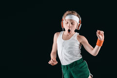 Portrait of sportive boy listening music in headphones Royalty Free Stock Photo