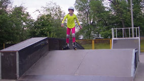 Portrait of a sportive child inline skates blading stock video