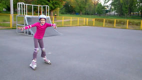 Portrait of a sportive child inline skating stock footage