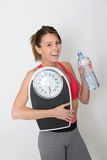 Portrait of sportive woman with bottle of water Stock Photo