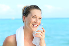 Portrait of sportive woman refreshing herself after working out Stock Photo