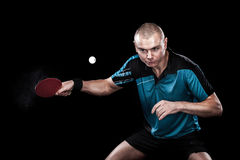 Portrait of sports man, male, athlete playing table tennis isolated on black background Stock Photos