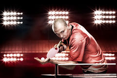 Portrait of sports man, male, athlete playing table tennis isolated on black background. Young sports man table tennis player is playing isolated on black Royalty Free Stock Image