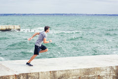 Portrait of a sports man running outdoors Stock Photo
