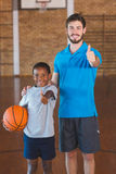 Portrait of sports teacher and schoolboy showing thumbs up Royalty Free Stock Photos